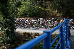 Peloton speed by on lap 4 at Grand Prix de Plouay Lorient Agglomération a 121.5 km road race in Plouay, France on August 26, 2017. (Photo by Sean Robinson/Velofocus)