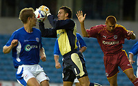 Photo: Daniel Hambury.<br />Millwall v Reading. Pre Season Friendly. 27/06/2006.<br />Millwall's Lenny Pidgeley gets in ahead of Reading's Steve Sidwell to grab the ball.