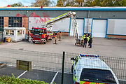 Leicester, United Kingdom, May 19, 2021: Negotiators are using a fire rescue truck at the Elbit UAV Tactical Systems factory to support security personnel in removing protestors from Palestine Action who occupied the rooftop of the Meridian Business Park in Braunstone Town, Leicester on Wednesday, May 19, 2021. (Photo by Vudi Xhymshiti/VXP)