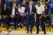 Philadelphia 76ers head coach Brett Brown talks with a referee during a game against the Golden State Warriors at Oracle Arena in Oakland, Calif., on March 14, 2017. (Stan Olszewski/Special to S.F. Examiner)
