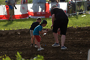 As the checked flag flew, fans climbed the fences and walked over the earth where Herlings and Cairoli, Jonass and Prado made grand prix history. These young fans picked up the lucky dirt to bring home.