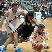 Besiktas's Bekir YARANGUME (L) and Efes Pilsen's Lawrence ROBERTS (C) during their Turkish Basketball league derby match Besiktas between Efes Pilsen at the BJK Akatlar Arena in Istanbul Turkey on Saturday 30 April 2011. Photo by TURKPIX