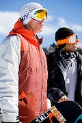 Snowboarders looking on. Keystone, Colorado