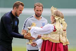 England's Harry Kane (left) and manager Gareth Southgate receive a Russian samovar - a heated metal container traditionally used to heat and boil water symbolizing hospitality during the training session at the Spartak Zelenogorsk Stadium, Repino.