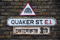 Quaker Street on corner of Brick Lane, Spitalfields, London. Borough of Tower Hamlets. Sign is in English & Bengali.