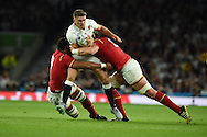 Owen Farrell  of England is stopped by Taulupe Faletau of Wales.   Rugby World Cup 2015 pool A match, England v Wales at Twickenham Stadium in London, England  on Saturday 26th September 2015.<br /> pic by  Andrew Orchard, Andrew Orchard sports photography.