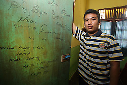 Bahagia Rahmatullah  (Rahmat) in his room at the Islamic boarding school in Banda Aceh where he stays all week, Aceh Province, Sumatra, Indonesia