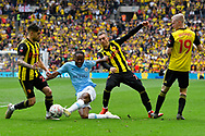 Raheem Sterling (7) of Manchester City is surrounded by Watford players as he battles for possession during the The FA Cup Final match between Manchester City and Watford at Wembley Stadium, London, England on 18 May 2019.