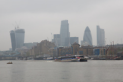 © Licensed to London News Pictures. 04/04/2014. London, UK. Smog continues to shroud the City of London skyline this morning, 4th April 2014. Weather forecasters predict pollution levels have peaked in London and that a westerly wind today will start to blow the smog away into the North Sea and clear the air. Photo credit : Vickie Flores/LNP