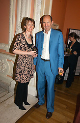 ROBIN WIGHT and his wife JANE MORGAN at a party to celebrate the publication of 'A Much Married Man' by Nicholas Coleridge held at the ESU, Dartmouth House,  37 Charles Street, London W1 on 4th May 2006.<br />