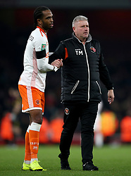 Blackpool's Nathan Delfouneso (left) and manager Terry McPhillips after the Carabao Cup, Fourth Round match at the Emirates Stadium, London.