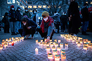 People lay candles during a  demonstration, commemorating the anniversary to the Hanau terror attack, in Berlin, Germany, February 19, 2021. About 800 participants took part in the event in remembrance of the Hanau shootings, in which ten people were killed and five others wounded. The shooting spree was committed on February 19, 2020 by a far-right extremist targeting two shisha bars and kiosks at the Hessian city of Hanau near Frankfurt. The gunman was identified as 43-year-old Tobias Rathjen. The majority of the victims were Germans with migrant backgrounds, among the victims was also the perpetrator's mother. (Photo by Omer Messinger)