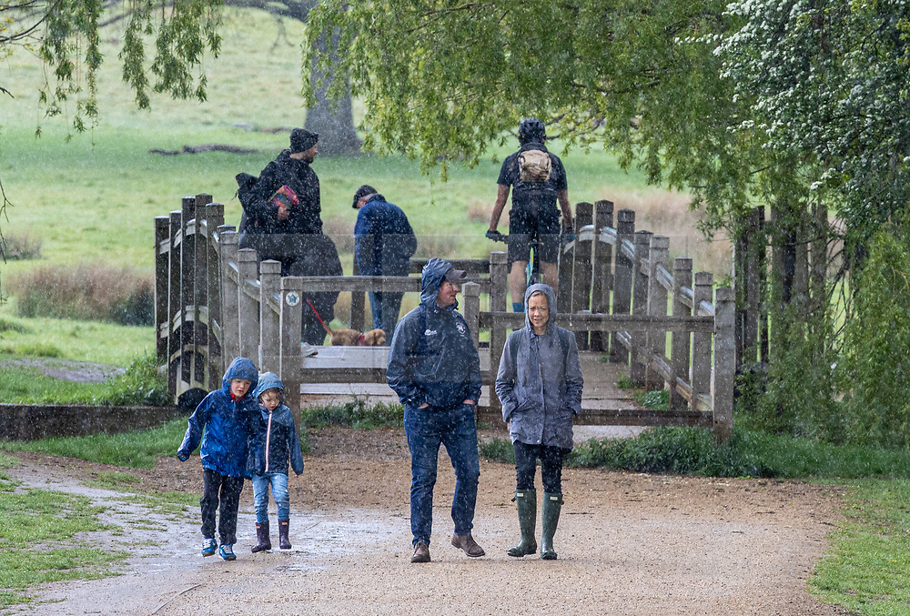 Licensed to London News Pictures. 15/05/2021. London, UK. Families make the most of the bad weather at Richmond Park, south west London today as miserable May continues with grey skies and more rain with temperatures down to 14c. Weather forecasters predict yet more showers for the rest of the weekend and into next week as the bad weather continues. Photo credit: Alex Lentati/LNP