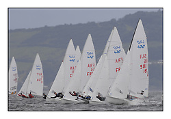 470 Class European Championships Largs - Day 2.Wet and Windy Racing in grey conditions on the Clyde...Men's fleet upwind, with SUI16, Yannick BRAUCHLI, Romuald HAUSSER, Segel Club Enge...
