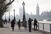 People walking along the famous riverfront walkway on winter light. The South Bank is a significant arts and entertainment district, and home to an endless list of activities for Londoners, visitors and tourists alike.