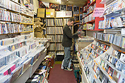 A man searching for vinyl records in a busy record shop on the 4th May 2018 in Welling in South East London the United Kingdom.