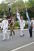 Australian military  marching with flags during Cairns ANZAC Day parade 2010. <br /> <br /> Editions:- Open Edition Print / Stock Image