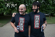 Jeremy Corbyn t-shirts sported by two friends at Theresa Mays Leaving Drinks in St Jamess Park in London, England, United Kingdom. Following the General Election, there has been a great deal of dismay concerning the legitimacy of the Conservative government and Conservative plans for Brexit, and this has sparked events, which although a satirical leaving party, also a political statement of discontent. A precursor to larger demonstration in London the following day.