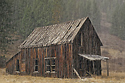 Landscape Photographer and Nature Decor Photography by Randy Wells, Image of an old barn during a hailstorm in the ghost town of Bodie, Okanogan, Washington, Pacific Northwest