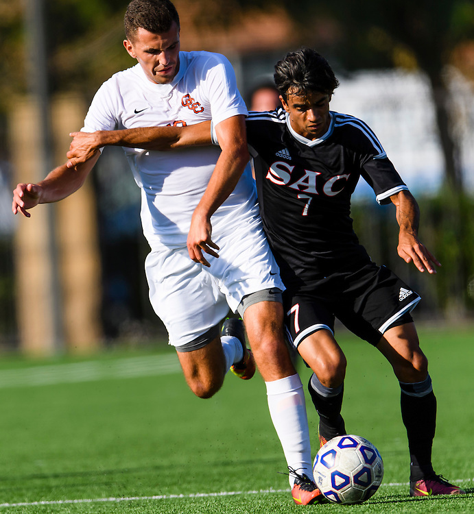 161104 Soccer, NCAA, Santa Ana College - Orange Coast College <br /> Brett Haney, OCC Pirates battling for the ball with Matheus Cuhna, SAC Dons.<br /> © Daniel Malmberg/Sports Shooter Academy 13