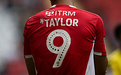 Close up of the Mind Charity branding on the back of Charlton Athletic's Lyle Taylor shirt