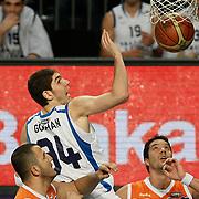 Anadolu Efes's Osman Gokhan Sirin (C) during their Turkish Basketball League match Anadolu Efes between Mersin BSB at Sinan Erdem Arena in Istanbul, Turkey, Saturday, January 14, 2012. Photo by TURKPIX