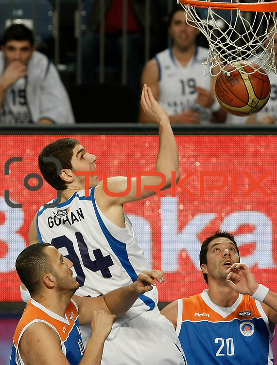 Anadolu Efes's Osman Gokhan Sirin (C) during their Turkish Basketball League match Anadolu Efes between Mersin BSB at Sinan Erdem Arena in Istanbul, Turkey, Saturday, January 14, 2012. Photo by TURKPIX