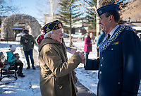 Horton Spitzer, left, and Ed Liebzeit shake hands after the American Legion Post 43's Veterans Day ceremony Monday at the Jackson Town Square. Spitzer served in the U.S. Navy during the Korean War and Liebzeit served two deployments with the Air Force in Vietnam.