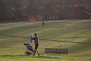 A father minds the baby in Brockwell Park in Herne Hill, Lambeth SE24 south London.