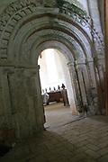 Norman doorway entrance Saint Andrew church, Westhall, Suffolk, England, UK
