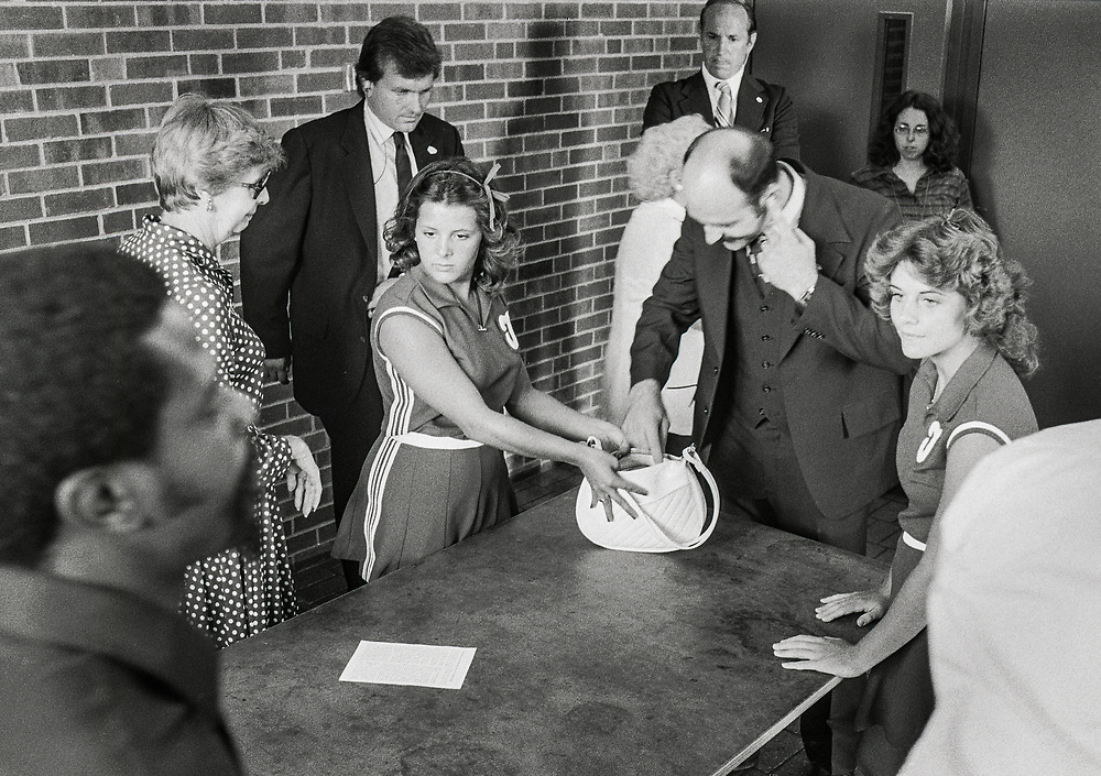 US security searching purses of Truman High School cheerleaders before President Jimmy Carter speaks at a Town Hall event in Independence, Missouri, September 2, 1980, during his re-election campaign.