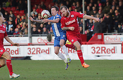 Peterborough United's Danny Swanson in action with Crawley Town's Mark Connolly - Photo mandatory by-line: Joe Dent/JMP - Tel: Mobile: 07966 386802 01/03/2014 - SPORT - FOOTBALL - Crawley - Broadfield Stadium - Crawley Town v Peterborough United - Sky Bet League One