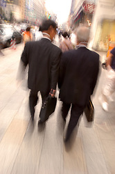 Motion blur image of businessmen walking on Tokyo Street