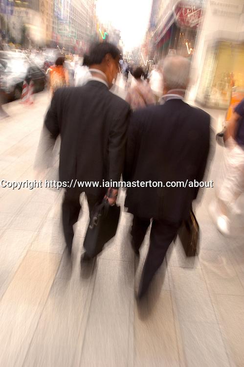 Motion blur image of businessmen walking on Tokyo Street