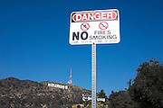 © Licensed to London News Pictures. 15/02/2015. Los Angeles, USA. A no fires/smoking sign near to the Hollywood sign.  Tourists photograph the Hollywood sign in Los Angeles, California. Photo credit : Stephen Simpson/LNP