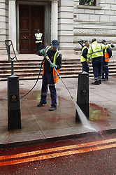 © Licensed to London News Pictures. 03/10/2019. London, UK. The clean up begins at the Treasury in Westminster after it had been sprayed in red paint by Extinction Rebellion activists . The stunt, which partly went wrong, was intended to cover the building in red dye looking like blood. Photo credit: Peter Macdiarmid/LNP