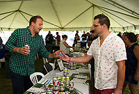 Brian Cronin pours Greg Merton a Vienna Lager from the Von Trapp Brewing during Gunstock Mountain's Brew and BBQ Fest on Saturday.  (Karen Bobotas/for the Laconia Daily Sun)