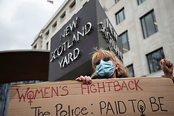 © Licensed to London News Pictures. 14/03/2021. London, UK. A woman holds a placard outside New Scotland Yard during a protest against the Police, Crime, Sentencing and Courts Bill 2021 that if passed will introduce new restrictions on protest. This demonstration comes after police arrested attendees at a vigil for Sarah Everard on Clapham Common last night.  Photo credit: George Cracknell Wright/LNP