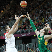 31 July 2012: Great Britain Joel Freeland takes a jumpshot over Brazil Tiago Splitter during 67-62 Team Brazil victory over Team Great Britain, during the men's basketball preliminary, at the Basketball Arena, in London, Great Britain.