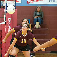 Rehoboth's Jessica Triplet looks to hit the ball as it comes off the net in pool play against Red Mesa Tuesday, Sept. 10 at Rehoboth Christian School's volleyball tournament.