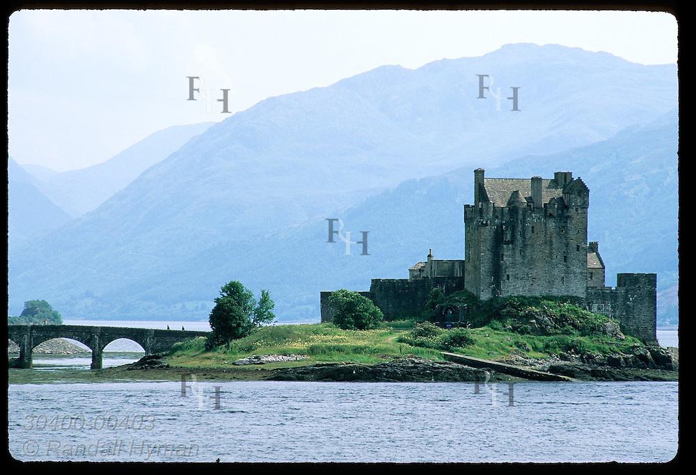 Stone bridge links Eilean Donan Castle to land at mouth of Loch Duich; Dornie. Scotland