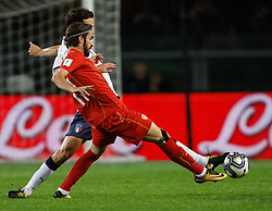 October 6, 2017 - Turin, Italy - Marco Parolo of Italy national team and Ferhan Hasani (in front) of FYR Macedonia national team vie for the ball during the 2018 FIFA World Cup Russia qualifier Group G football match between Italy and FYR Macedonia at Stadio Olimpico on October 6, 2017 in Turin, Italy. (Credit Image: © Mike Kireev/NurPhoto via ZUMA Press)
