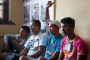 Nepalese teenagers put their hands up to answer a question during a life skills training session in Bisaneu Voice of Children centre in Kathmandu, Nepal.  The session is part of the rehabilitation program run by Voice of Children.  The not-for-profit organisation supports street children and those who are at risk of sexual abuse through educational and vocational training opportunities, health services and psychosocial counseling.