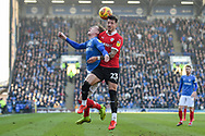 Portsmouth Midfielder, Ronan Curtis (11) and Barnsley Defender, Daniel Pinillos (23) challenge for the ball during the EFL Sky Bet League 1 match between Portsmouth and Barnsley at Fratton Park, Portsmouth, England on 23 February 2019.