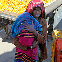 Asia, India, Rajasthan. Mother holds child in Rajasthan.