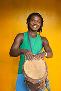Portrait of a smiling young male local musician holding drum, Little Corn Island, Nicaragua