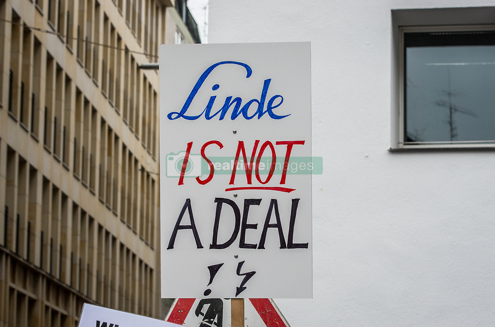 "April 27, 2017 - MüNchen, Bayern, Germany - Employees of Munich-based, multi-national industrial gas giant Linde AG (Ling De) have launched protests and marches in numerous cities throughout Germany against the planned merger between Linde AG and US competitor Praxair (PX.n).  The employees and unions fear elimination of positions and reduced control over their affairs.  Linde Supervisory Board Chairman Wolfgang Reitzle has been embattled for several months over the deal, which would create a $30 billion market leader and have a $1 billion synergy target, , but mounting crises also include an investigation of Reitzle by BaFin, Germany's Federal Financial Supervisory Authority, for potential insider trading that revolved around this merger.  Despite no involvement whatsoever by Trump, anti-Trump rhetoric was abound, as was anti-American rhetoric as an prominent angle of their resistance to this deal.  Ironically, despite citing ""America First"" at one point, the rest appeared to be ""Germany First"" rhetoric for non-acceptance of the merger.  The unions and workers alluded that if a merger is ratified, they would not be cooperative..Praxair has provided assurances to Linde regarding maintainance of jobs and corporate climate and governance after early rounds of negotiations fell through over these issues.  IG Metall spokespeople have indicated that the assurances don't resolve all the grievances.  Steve Angel, Praxair CEO, released a video in January that assured his employees would be in charge.  Praxair has approximately double the profitability of Linde.  The video has since been filed with the US SEC. (Credit Image: © Sachelle Babbar via ZUMA Wire)"