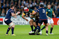 South Africa replacement Schalk Brits is tackled by USA Prop Chris Baumann - Mandatory byline: Rogan Thomson/JMP - 07966 386802 - 07/10/2015 - RUGBY UNION - The Stadium, Queen Elizabeth Olympic Park - London, England - South Africa v USA - Rugby World Cup 2015 Pool B.