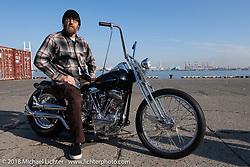 Dynamite Joe Kerivan with his 1957 Harley-Davidson Panhead at the docks early on setup day for the 27th Annual Mooneyes Yokohama Hot Rod Custom Show 2018. Yokohama, Japan. Saturday, December 1, 2018. Photography ©2018 Michael Lichter.