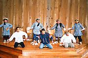Alaska, Anchorage, Alaska Native Heritage Center. Nunaniq Eskimo dancers performing on stage.